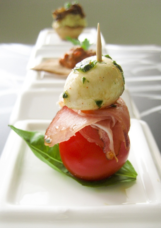 Marinated bocconcini (mini mozzarella balls), prosciutto and cherry tomato skewers